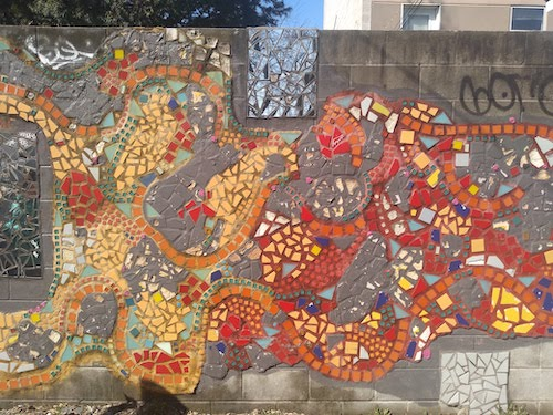 Cheerful image of an abstract mosaic on a wall.